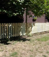 Photo of a residential picket fence.