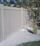 Photo of a solid cedar residential fence.