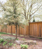 Photo of a solid wood privacy fence.