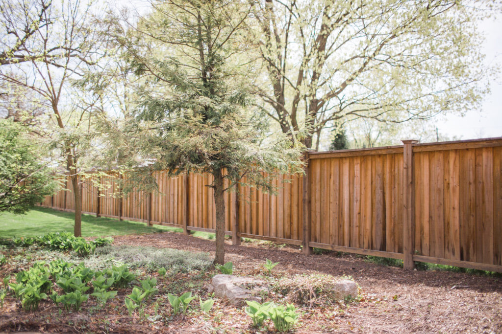 Photo of a residential wood fence.