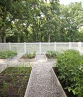 Photo of a white residential garden fence.
