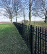 Photo of a black ornamental fence.