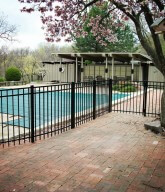 Photo of a residential fence surrounding a pool.