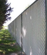 Photo of a residential chainlink fence.