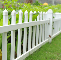 Photo of a white backyard fence.