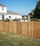 Photo of a residential wood picket fence.