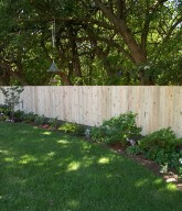 Photo of a residential solid wood fence.