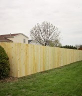 Photo of a solid residential wood fence/privacy fence.