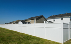 Photo of a white residential fence.