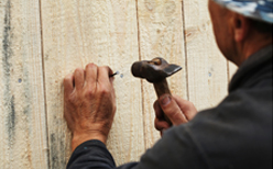 Photo of a fence contractor during a new fence installation.