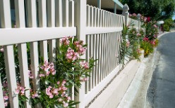 White vinyl fencing in Champaign IL with flowers hanging on it