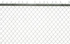 A chain link fence in Peoria IL against a white background