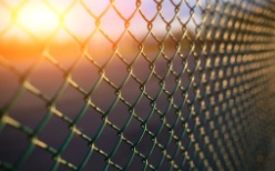 Chain Link Fence in Peoria IL with the sun setting behind it