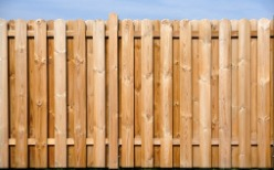 A tall wood Privacy Fence in Bloomington IL